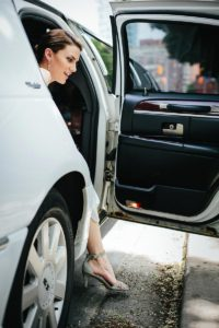 bride exits limo - toronto wedding photography tips
