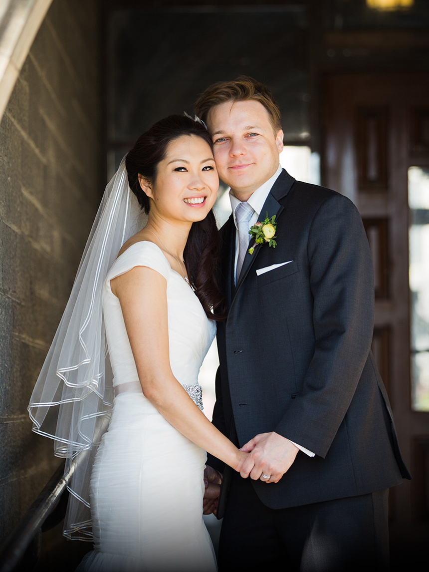 Posed wedding photo of a couple at Hart House in Toronto.