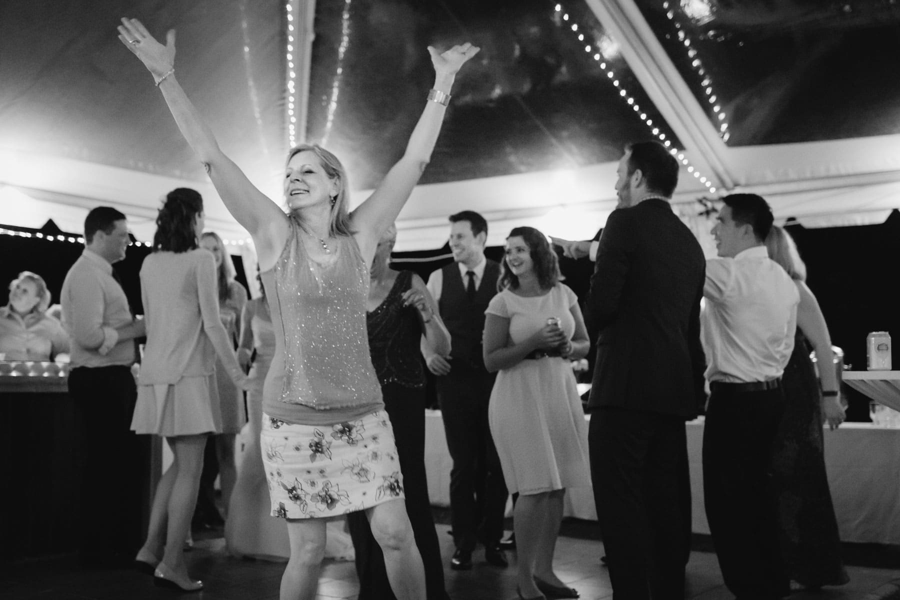 A woman dances under a white tent in these backyard wedding photos.