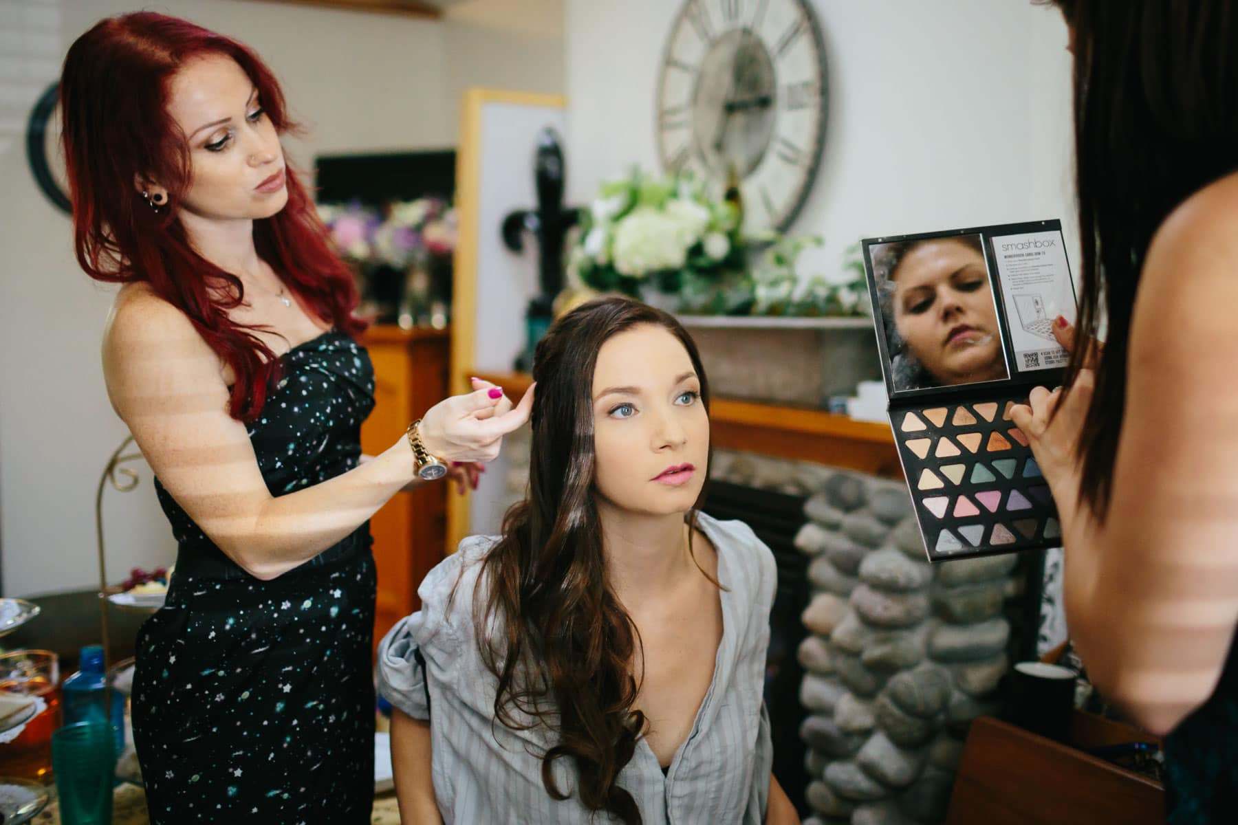 Bride's makeup being applied and hair being done in this rustic Ball's Falls wedding.
