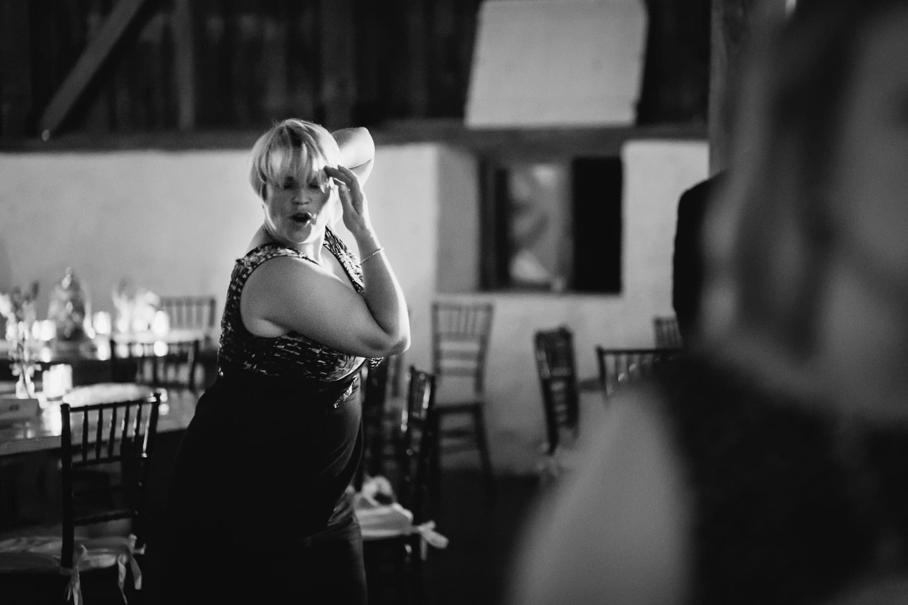 A woman strikes a pose during a dance at this Ball's Falls, Ontario wedding.