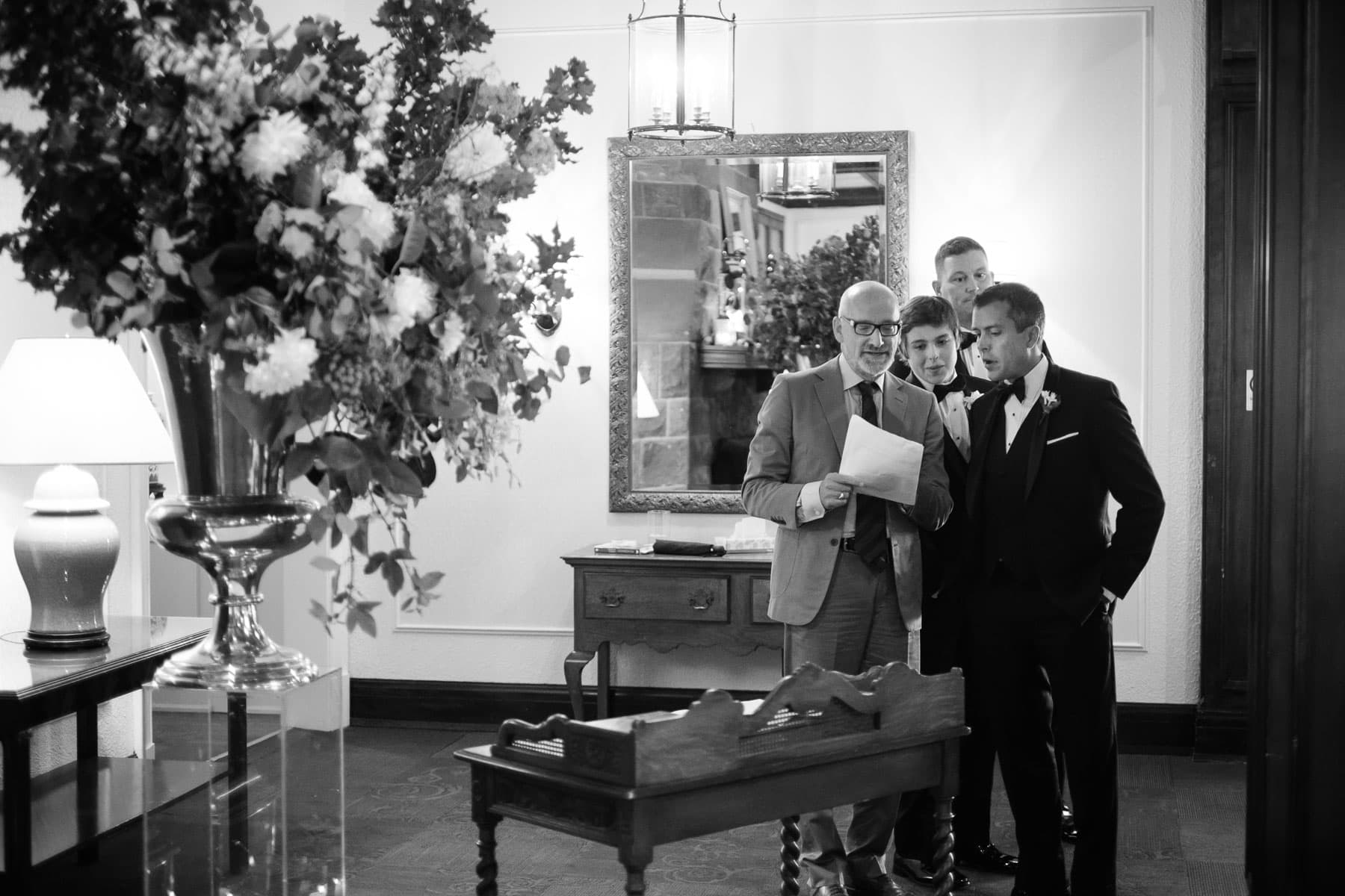 The officiant goes over the last details with the groom just before the ceremony begins at this Boulevard Club wedding in Toronto.