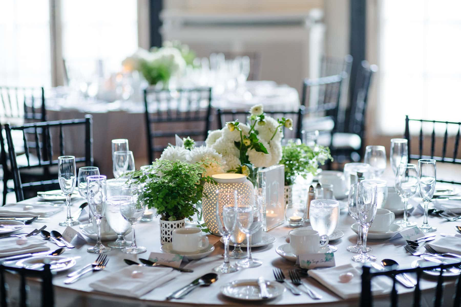 Table setting and floral decorations at this Boulevard Club wedding in Toronto.