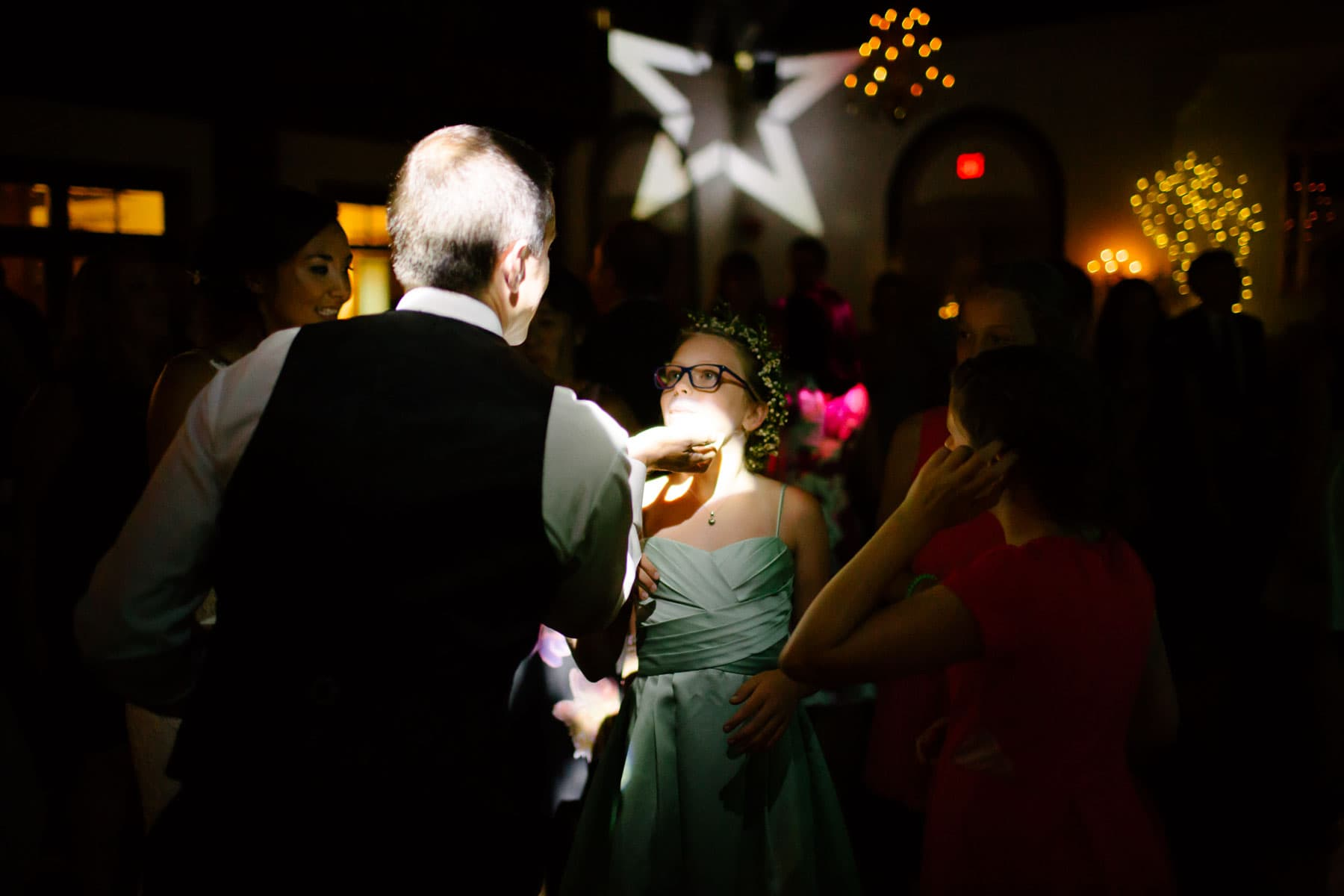 A man dances with his adolescent daughter on the dark dance floor at this Boulevard Club wedding in Toronto.
