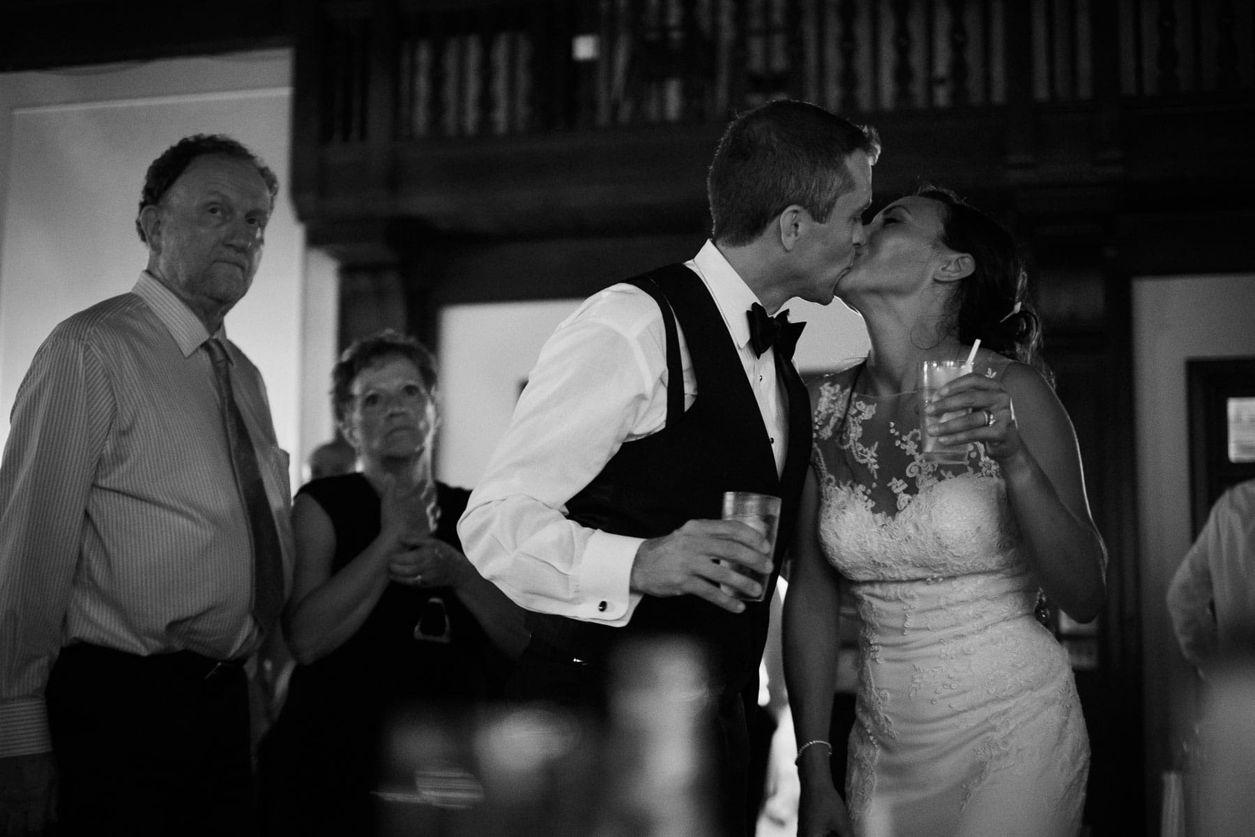 The bride and groom kiss at the end of the night at this Boulevard Club wedding.
