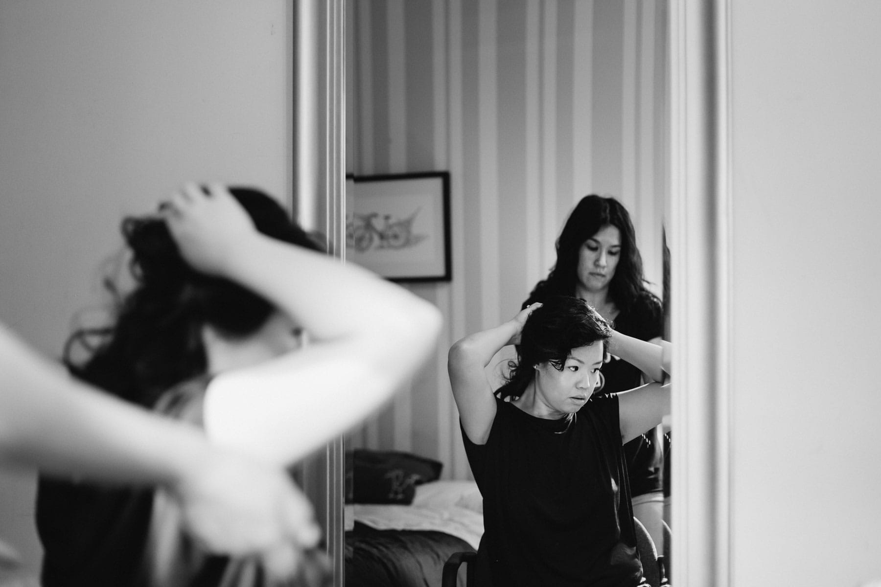 Bride does her hair in room, Artscape, Toronto Island wedding