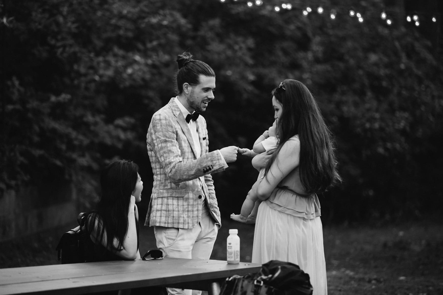 Man shakes hands with baby, Artscape, Toronto Island wedding