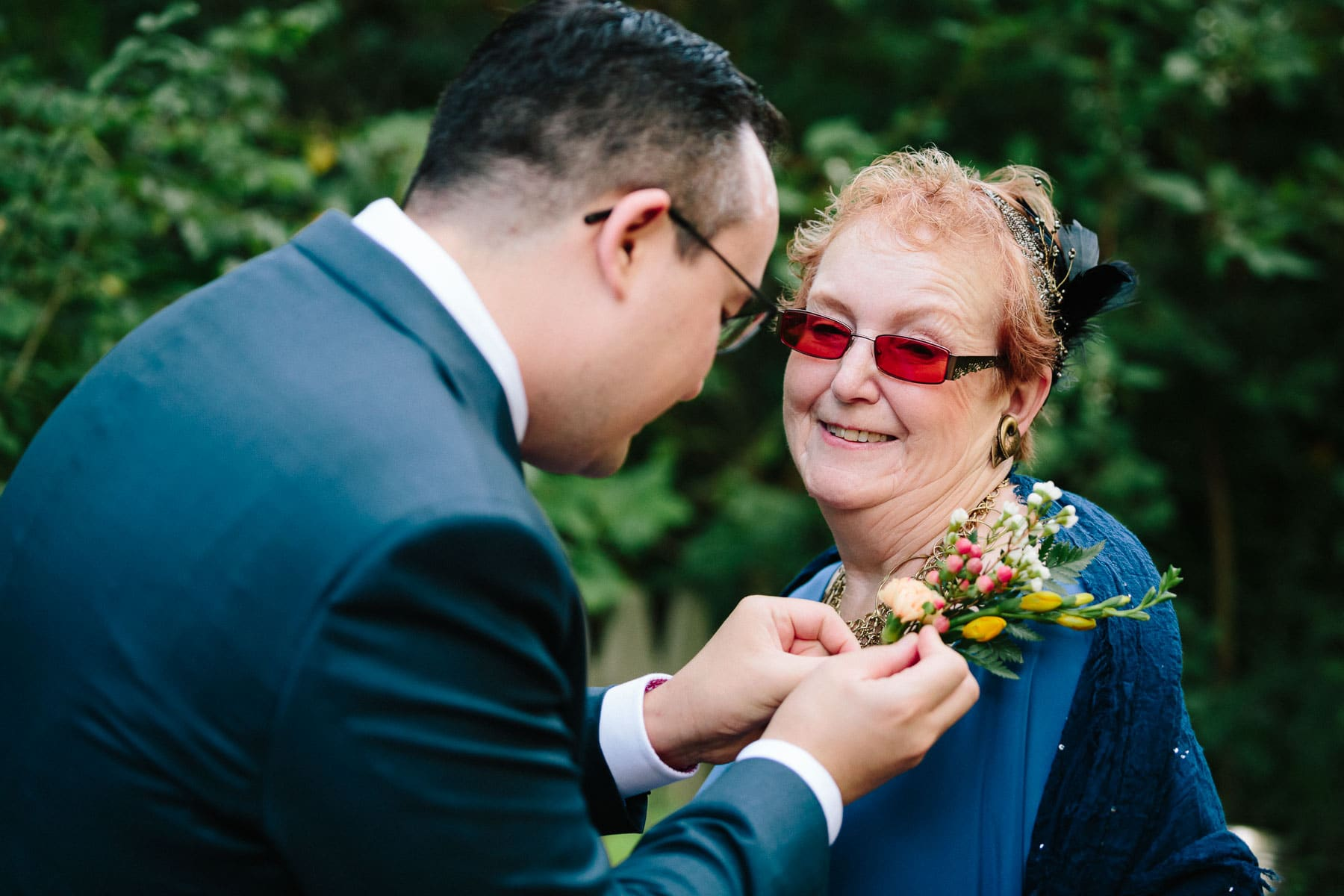Groom pins flowers to mother, Artscape, Toronto Island wedding