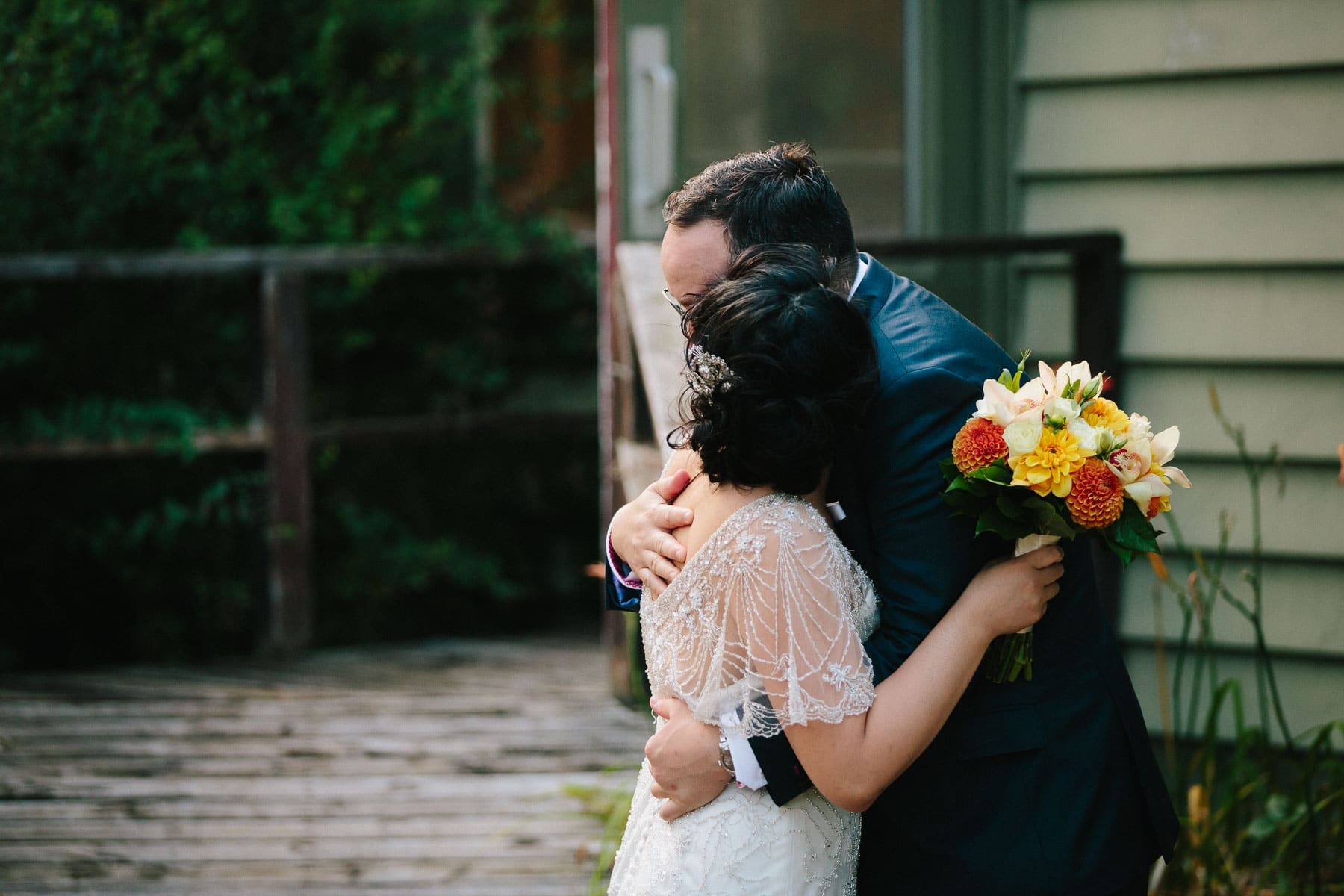 Bride hugs groom at Artscape, Toronto Island wedding