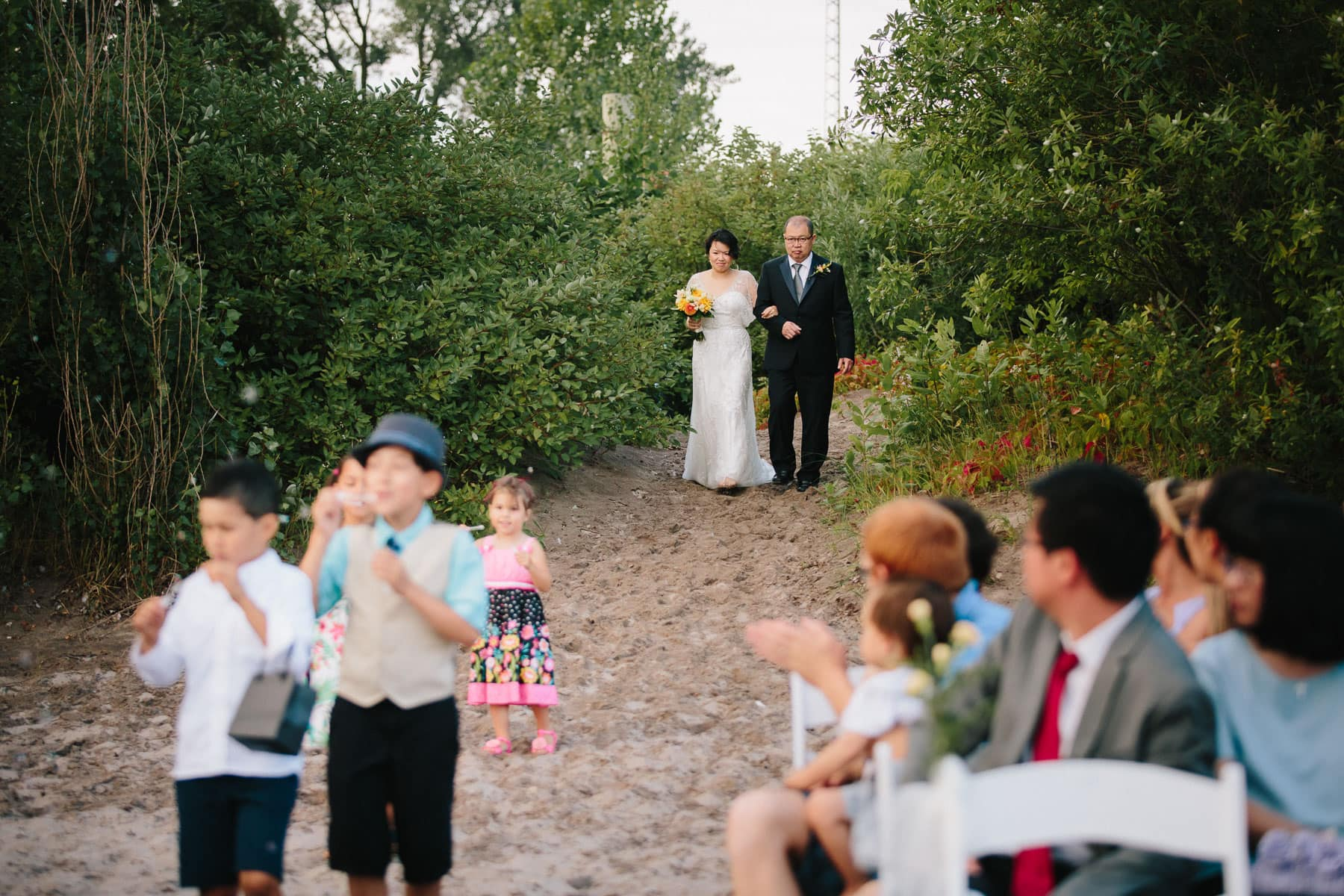 Father walks bride down beach, Artscape, Toronto Island wedding