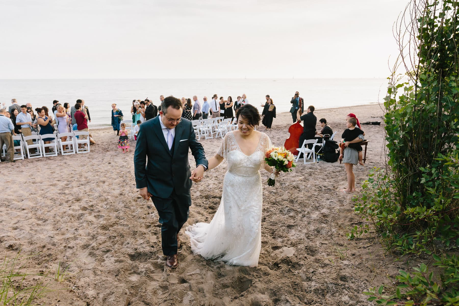 Bride and groom walking on sand, Artscape, Gibraltar Point, Toronto Island wedding