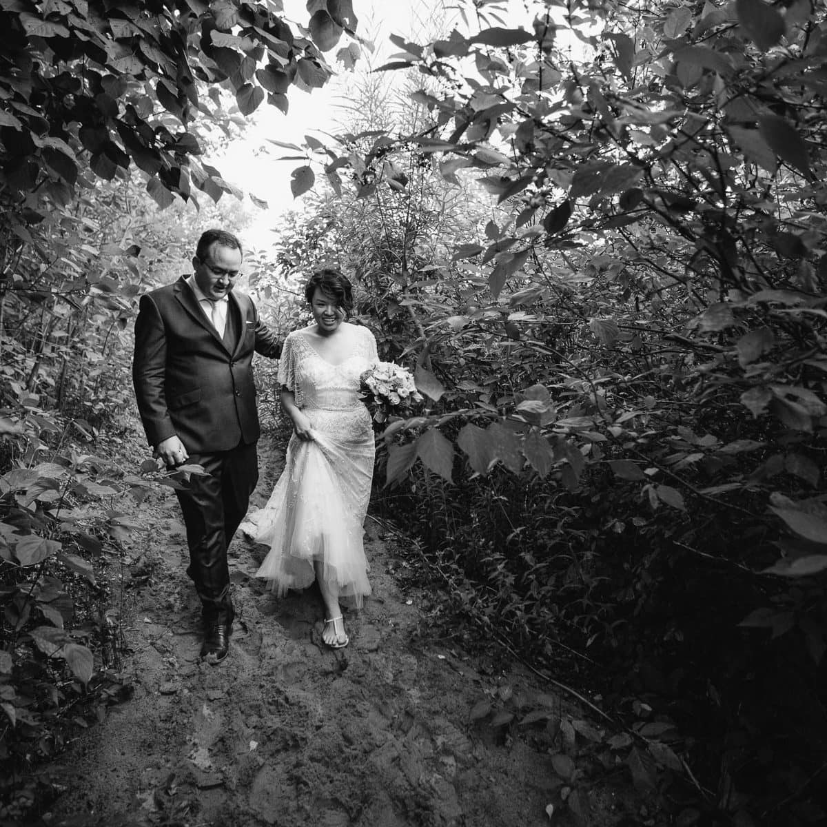 Bride and groom walking down path, Artscape, Gibraltar Point, Toronto Island wedding