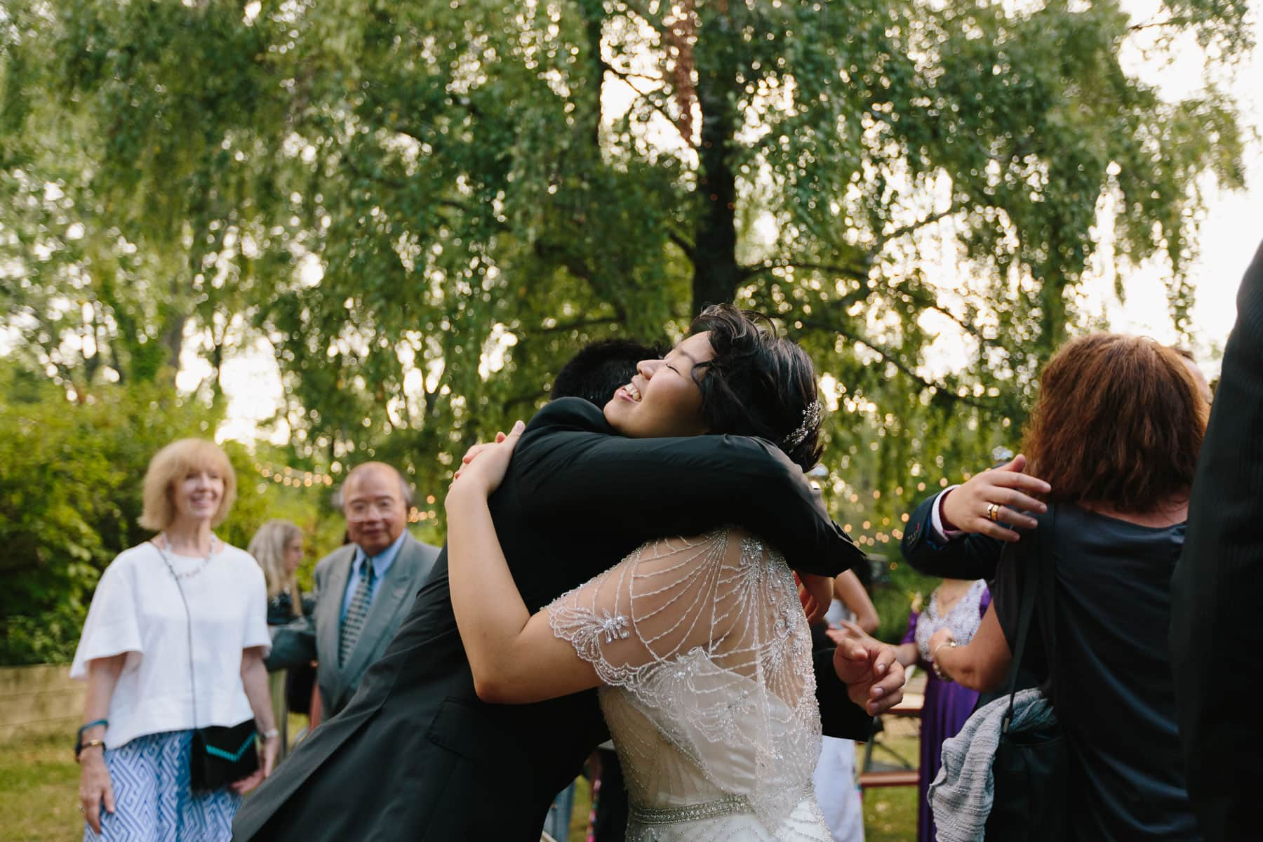 Bride hugging guest, Artscape, Gibraltar Point, Toronto Island wedding