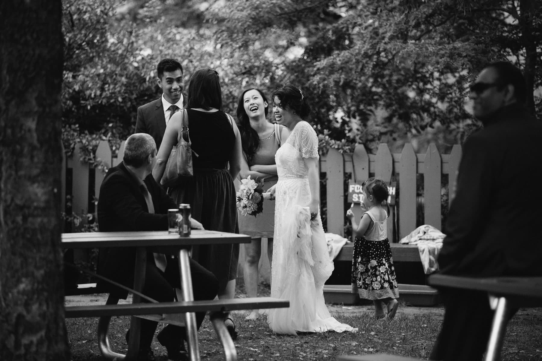 Bride laughing with guests, Artscape, Gibraltar Point, Toronto Island wedding