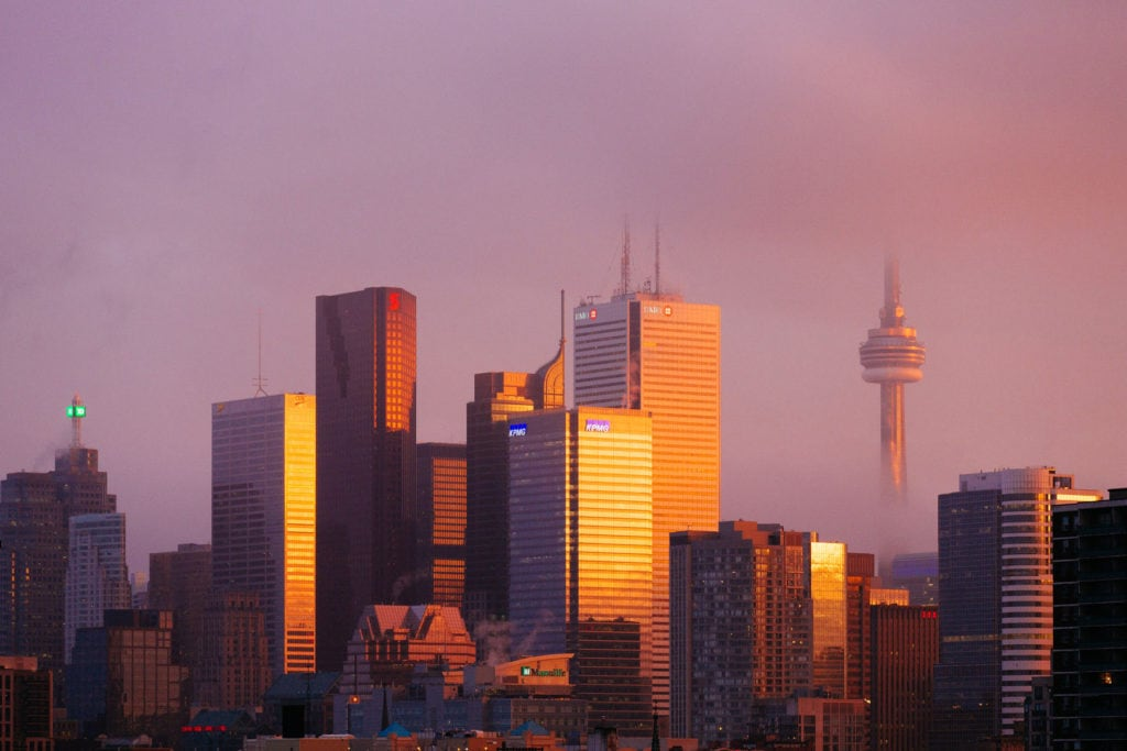 Average price of wedding photography in Toronto. Skyline sunset orange