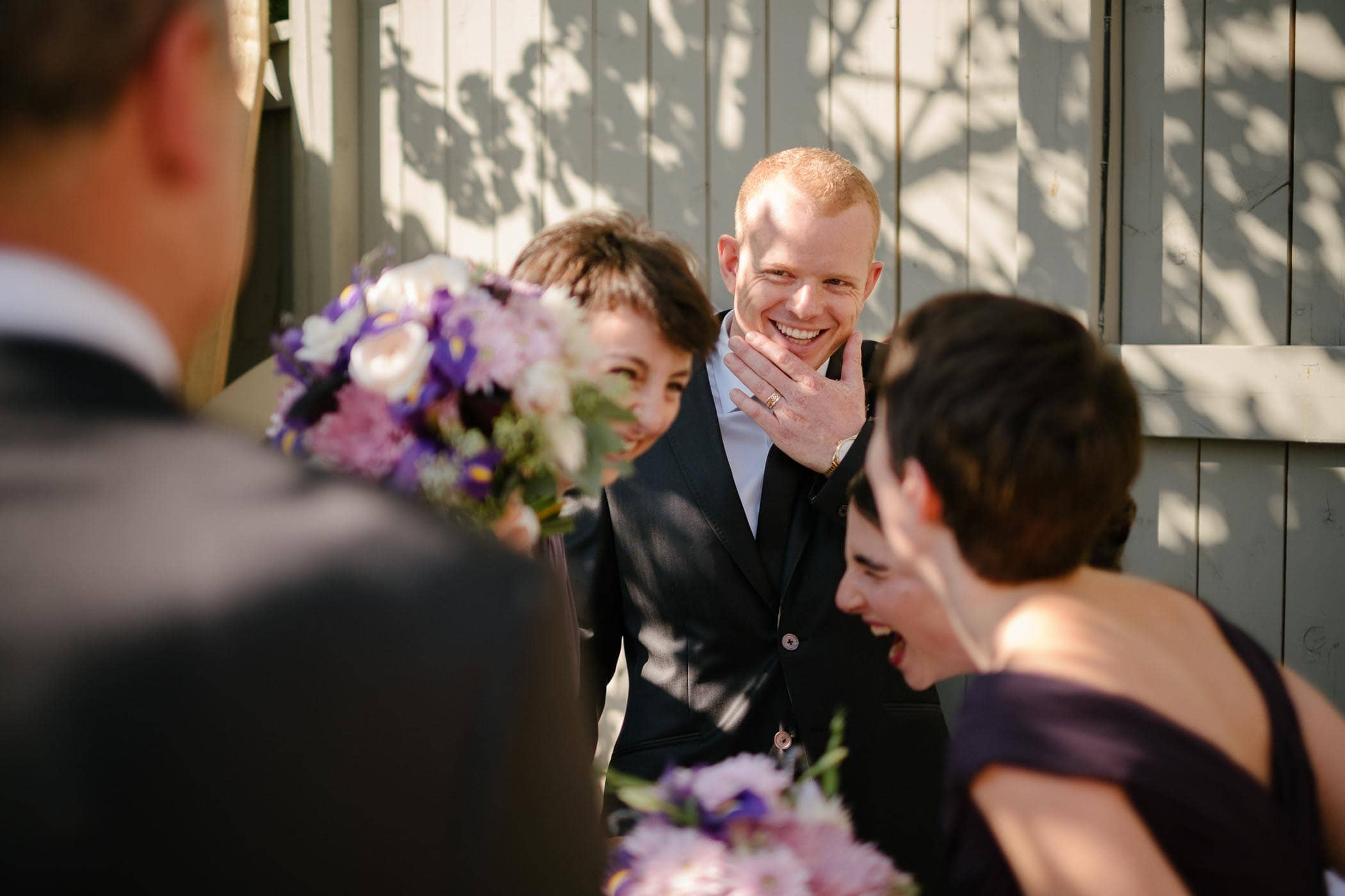 The bride and groom and bridal party laughing at a joke after wedding ceremony at glenerin inn and spa in mississauga.