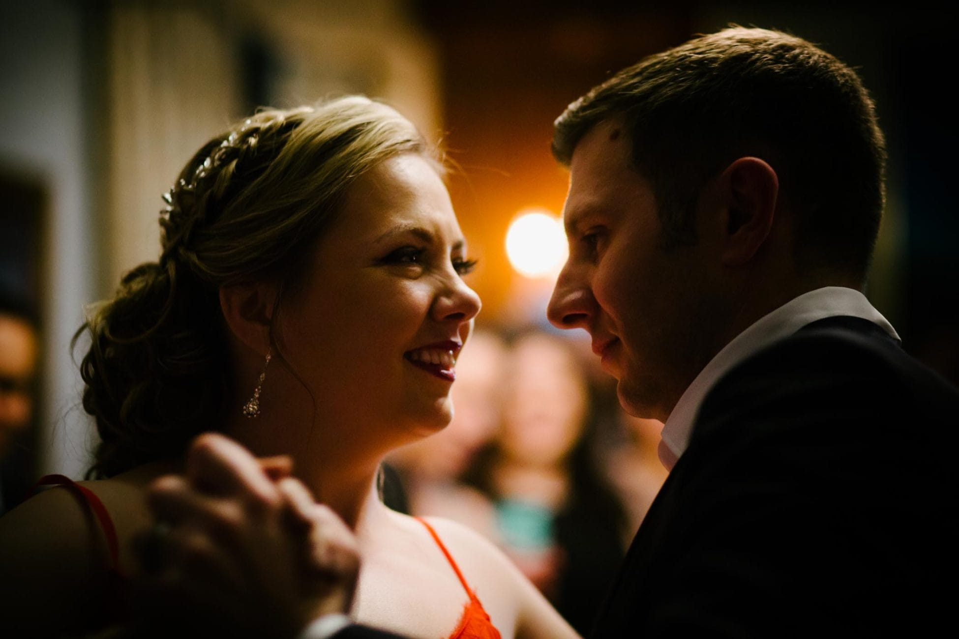 Bride and groom's first dance in the dim evening light of McLean House at the Estates of Sunnybrook in Toronto.