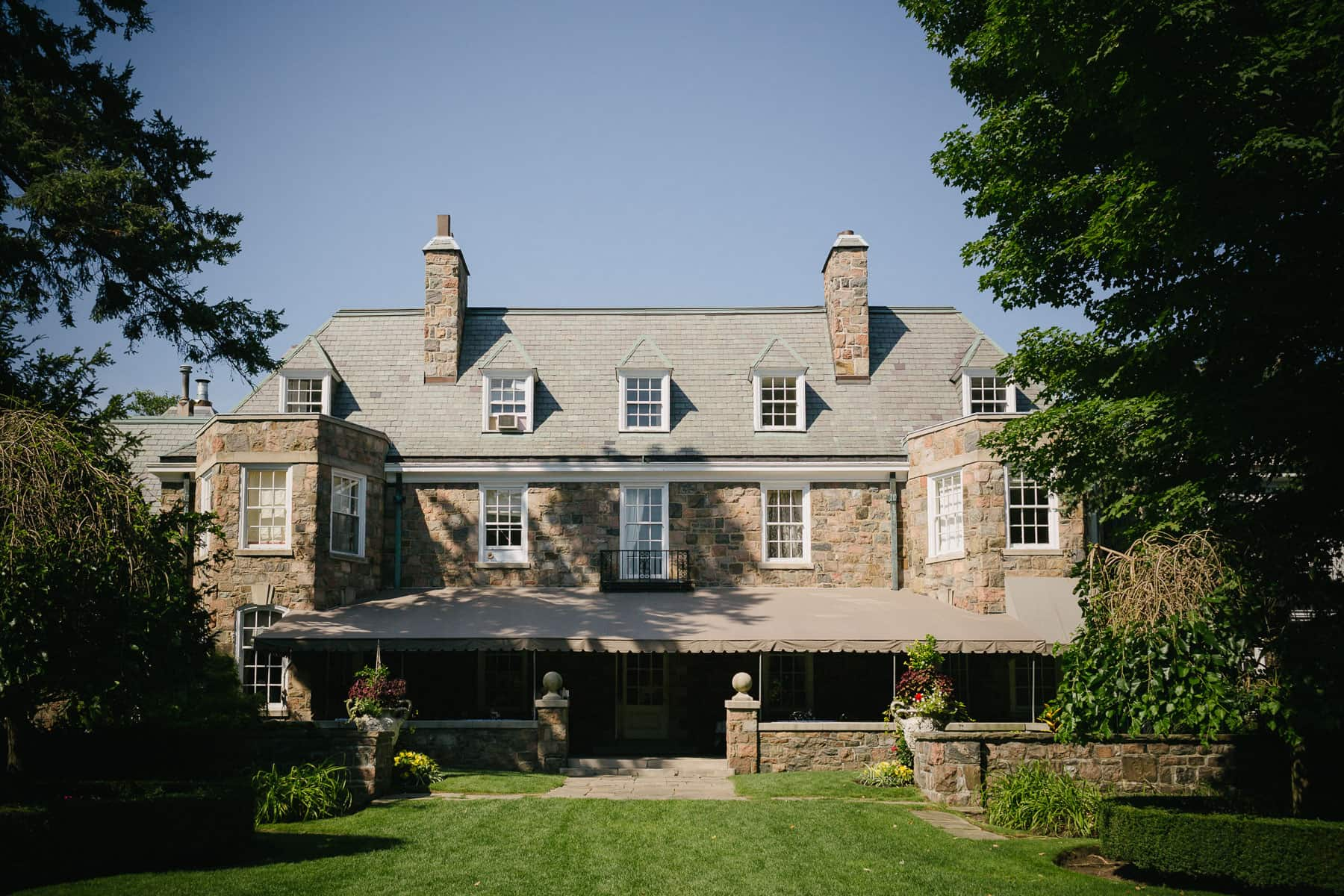 Wide exterior shot of back of McClain House, Estates of Sunnybrook during sunny afternoon.