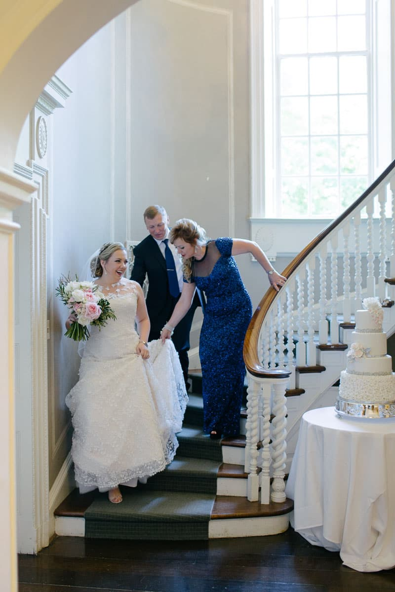 Bride's parents help her down the spiral staircase of McClain House, Estates of Sunnybrook.