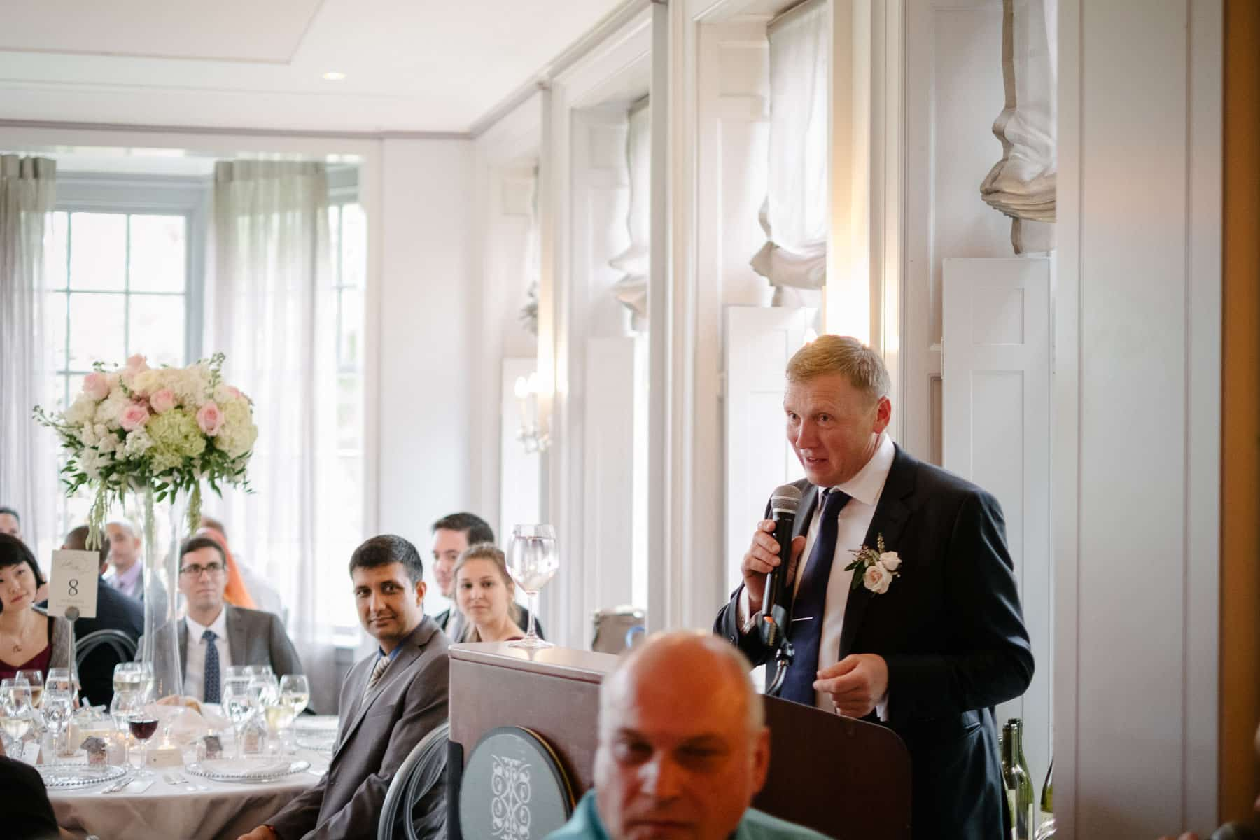Bride's father gives a speech and toast in dinner hall of McClain House, Estates of Sunnybrook.