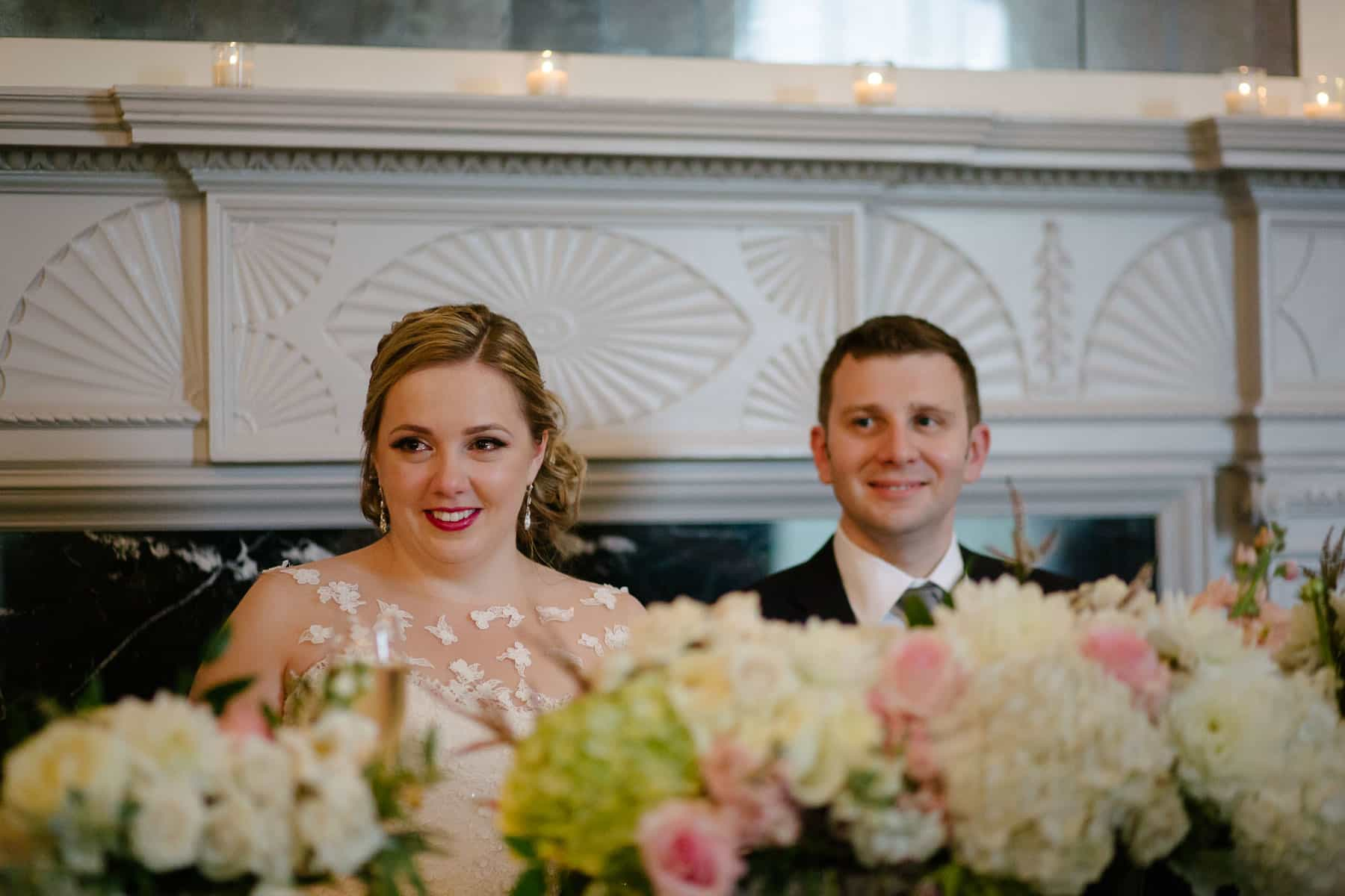 Bride teary-eyed and smiling at reception at McClain House, Estates of Sunnybrook.