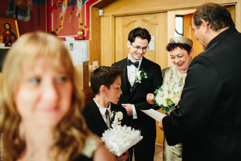 Photojournalistic wedding photography ceremony, groom with guests