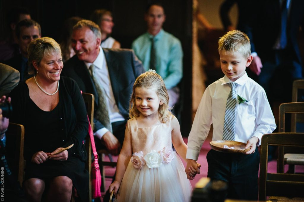 Documentary wedding photography ceremony, flower girl and page boy procession.