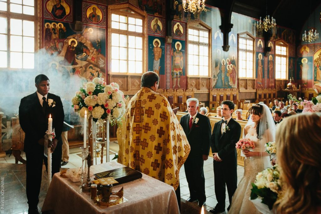 Photojournalistic wedding photography ceremony, incense smoke during Orthodox Christian ceremony.
