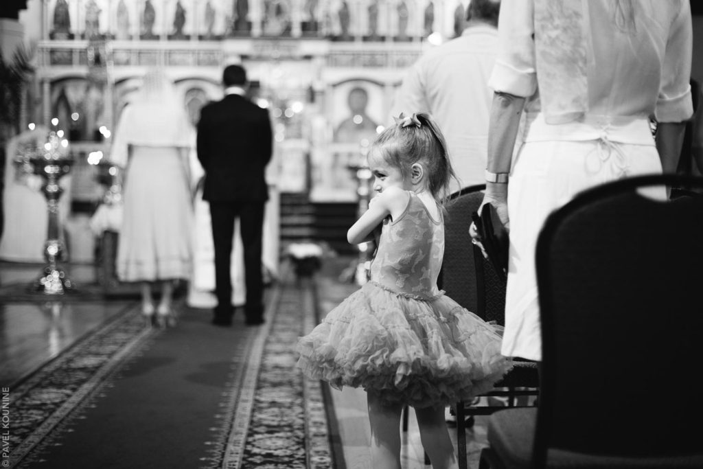 Photojournalistic wedding photography ceremony, girl in tutu.