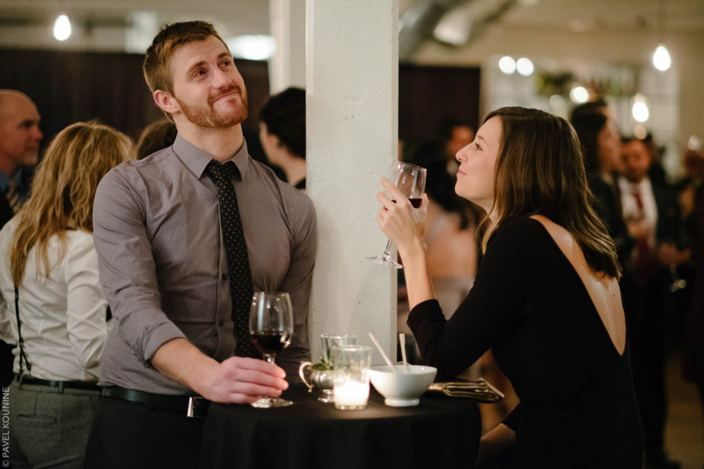 A male and female guest in conversation during cocktail reception.