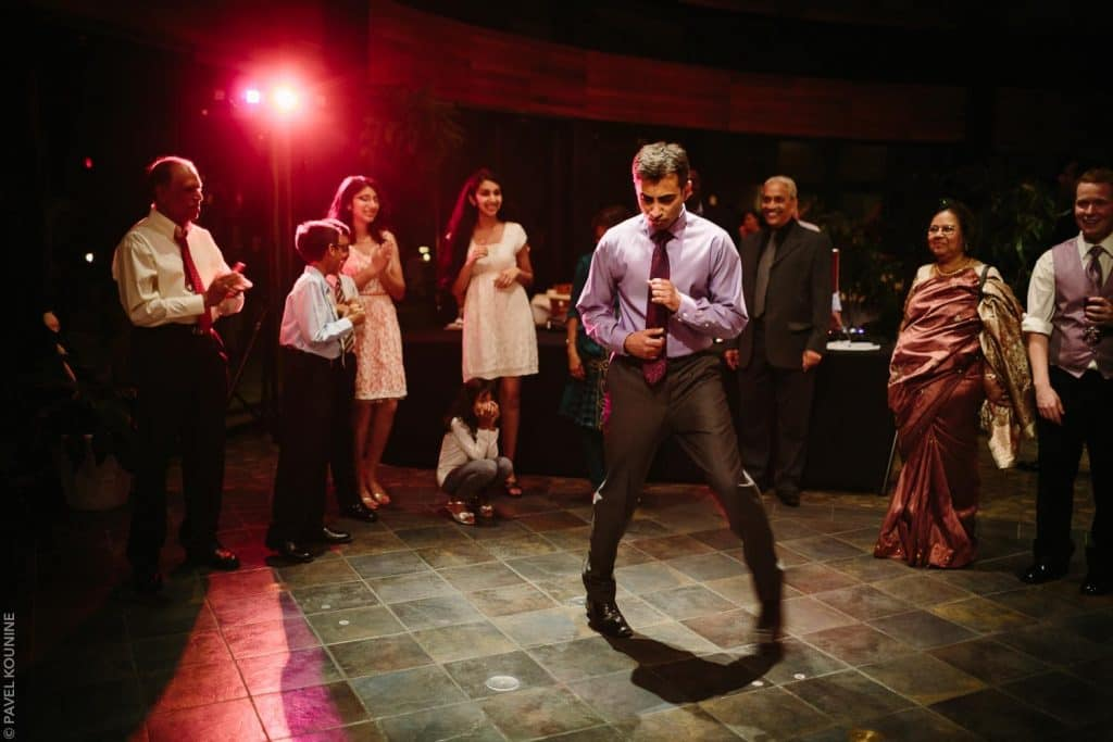 Documentary wedding photography dancing party, man dancing like Michael Jackson.