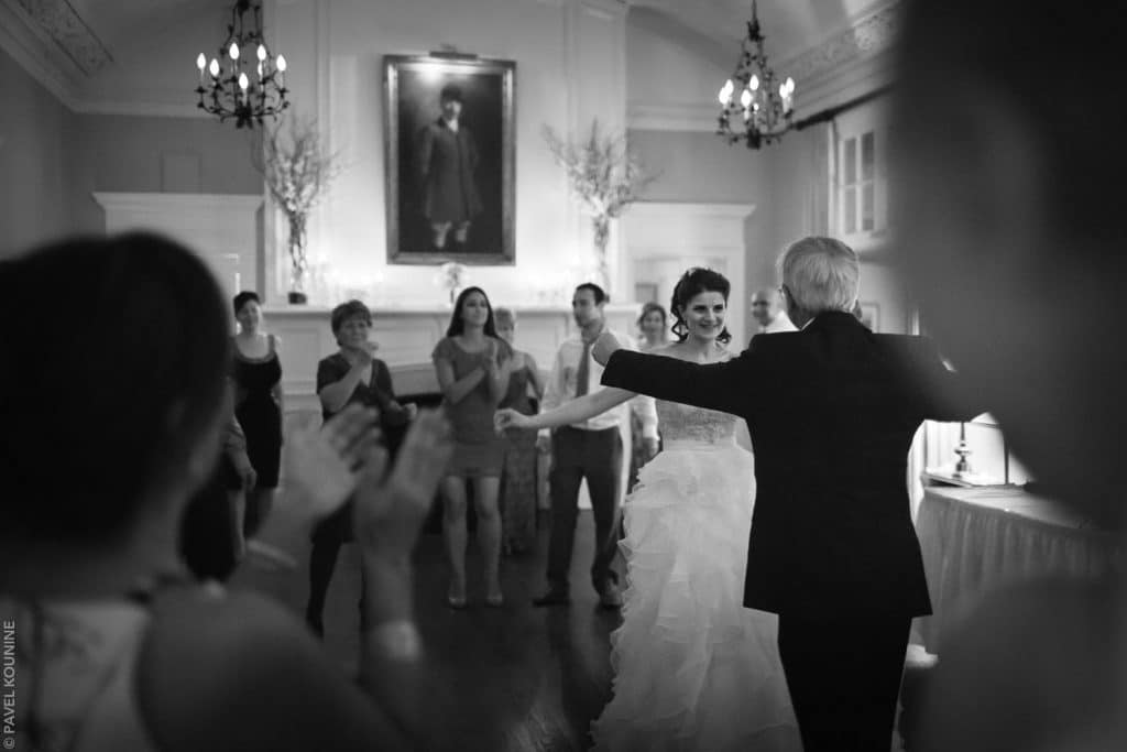 Photojournalistic wedding photography of bride dancing with father to Iranian music.