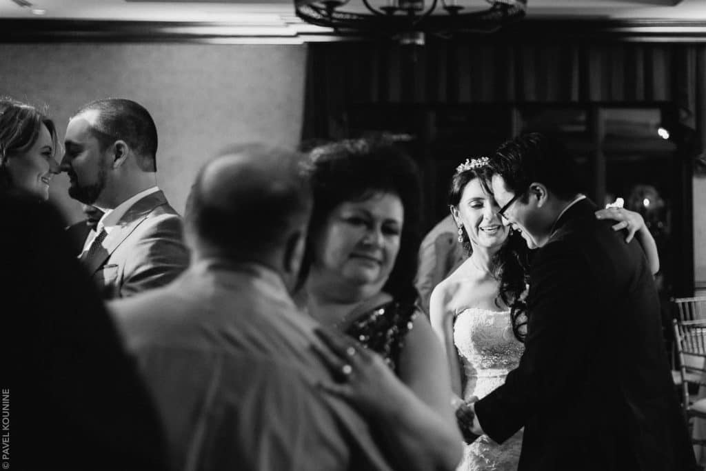 The bride dances with friend during late night party.