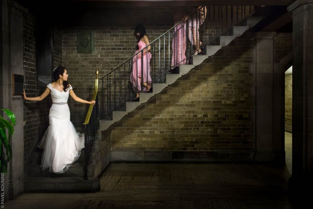 Bride and bridesmaids descending the stairs at Hart House.