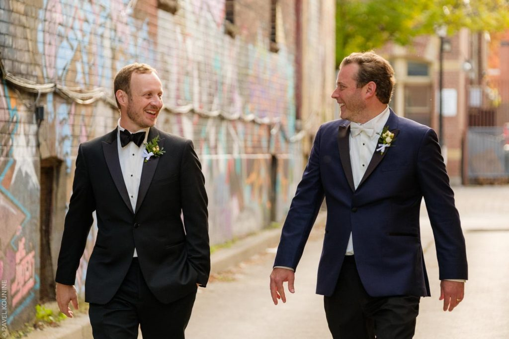 Minimally posed portrait of groom and best man in graffiti alley in Toronto.