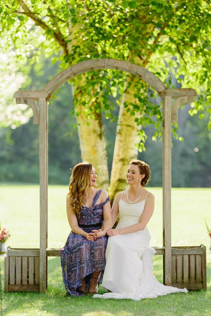 Bride and maid of honour portrait by two birch trees.
