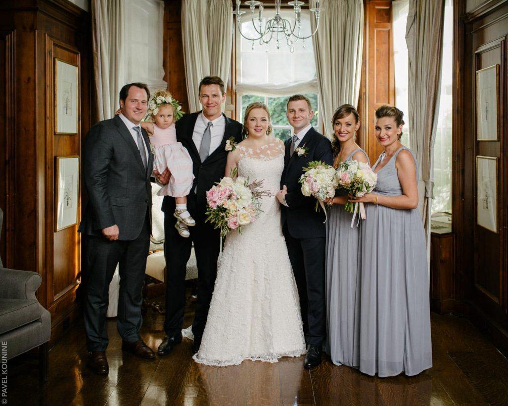 Formal wedding group portrait inside Estates of Sunnybrook.