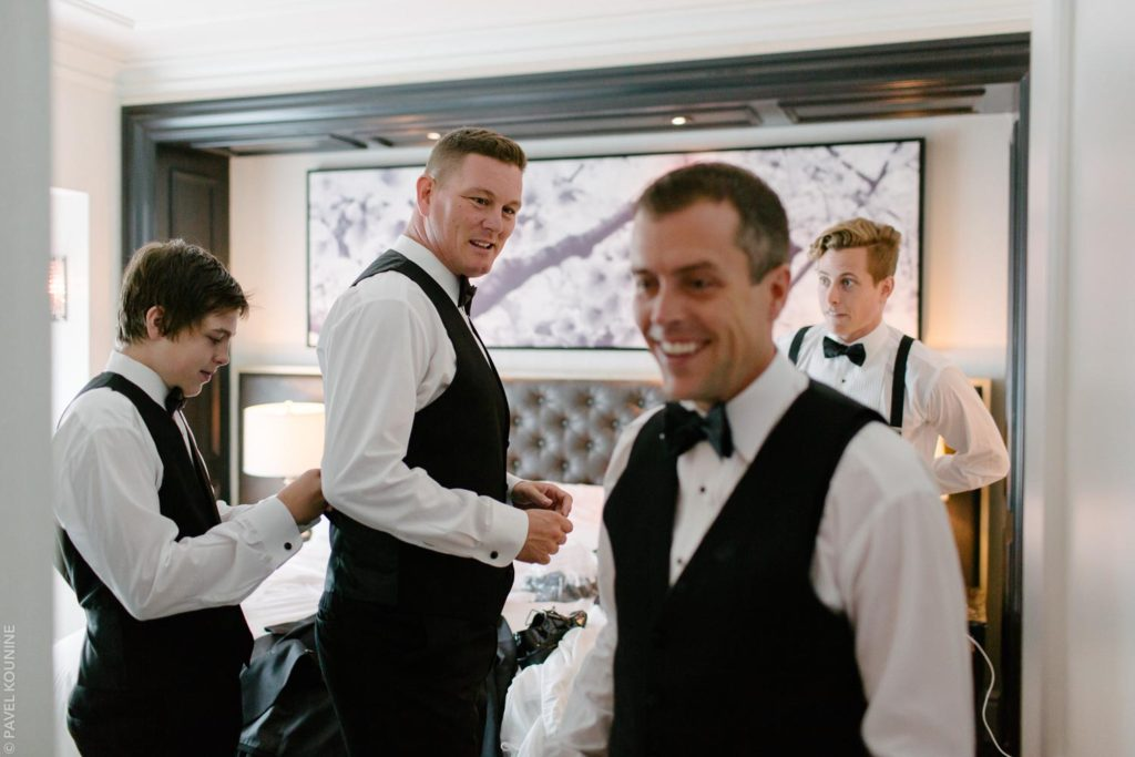 Groom and three men inside the Trump hotel Toronto.