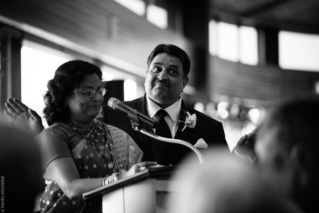 Parents of the groom giving a speech during dinner reception.