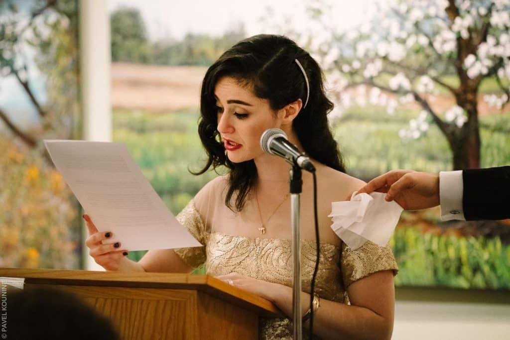 Bride cries during speech.