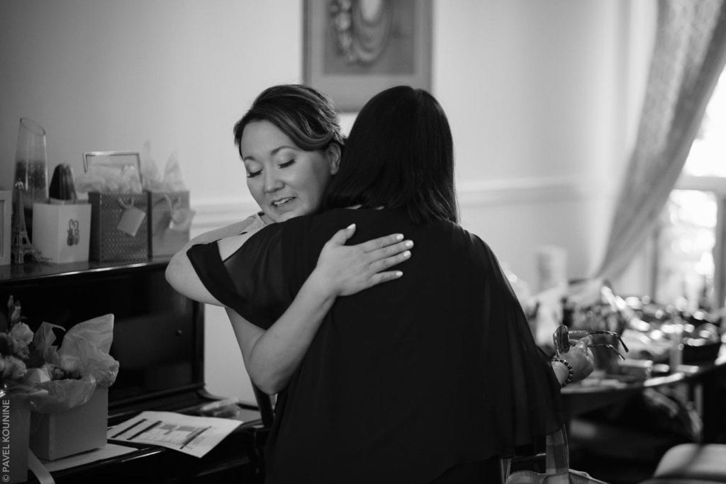 Timeless wedding photography of the bride hugging her mother prior to leaving for the church ceremony.