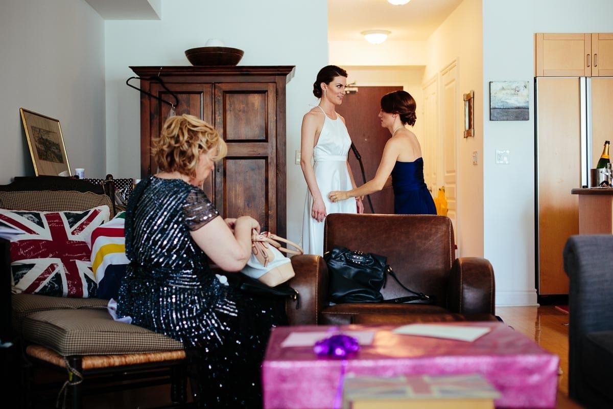 The bride is wearing her wedding dress.
