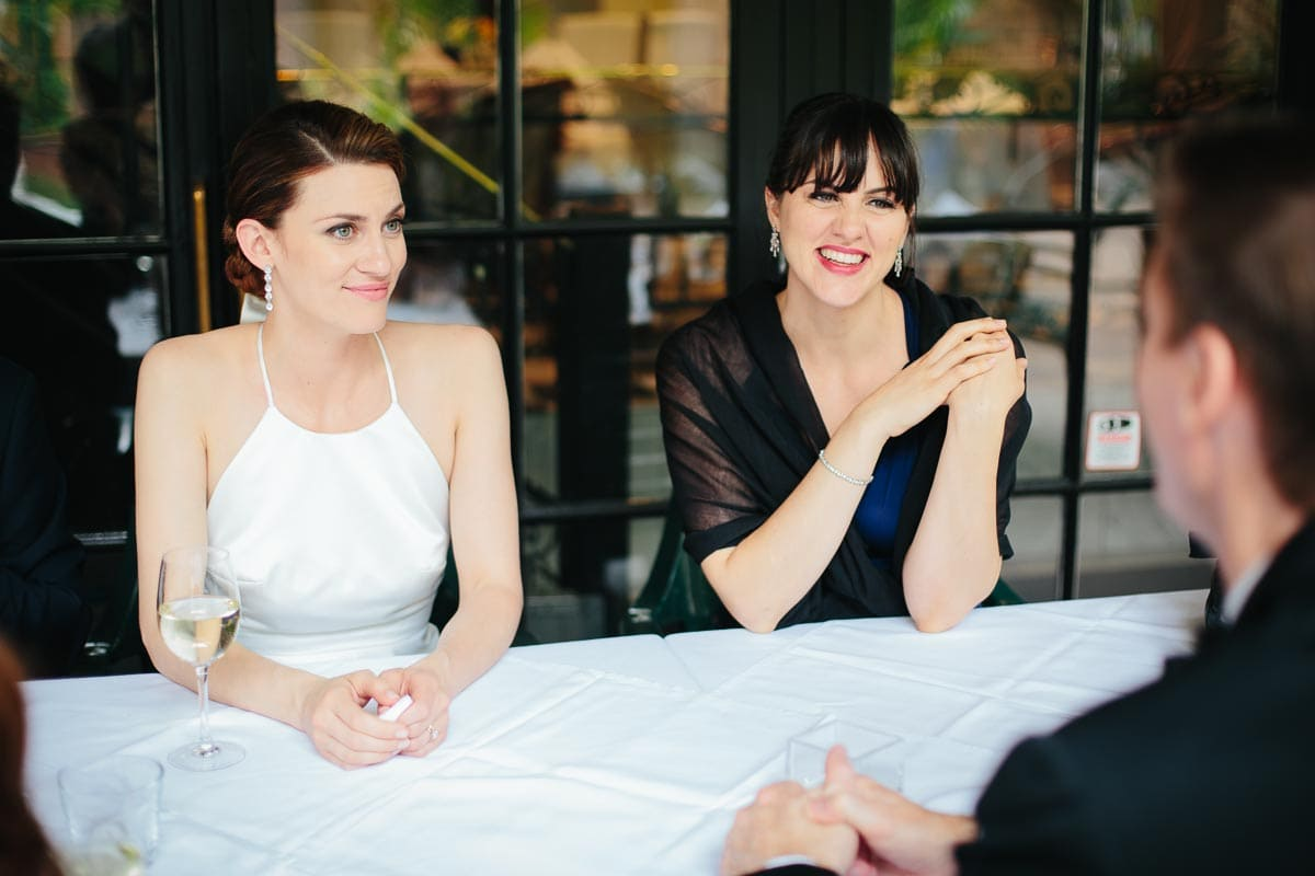 The bride and bridesmaid (her sister) converse with other members of wedding party during a brief interlude at La Maquette restaurant.