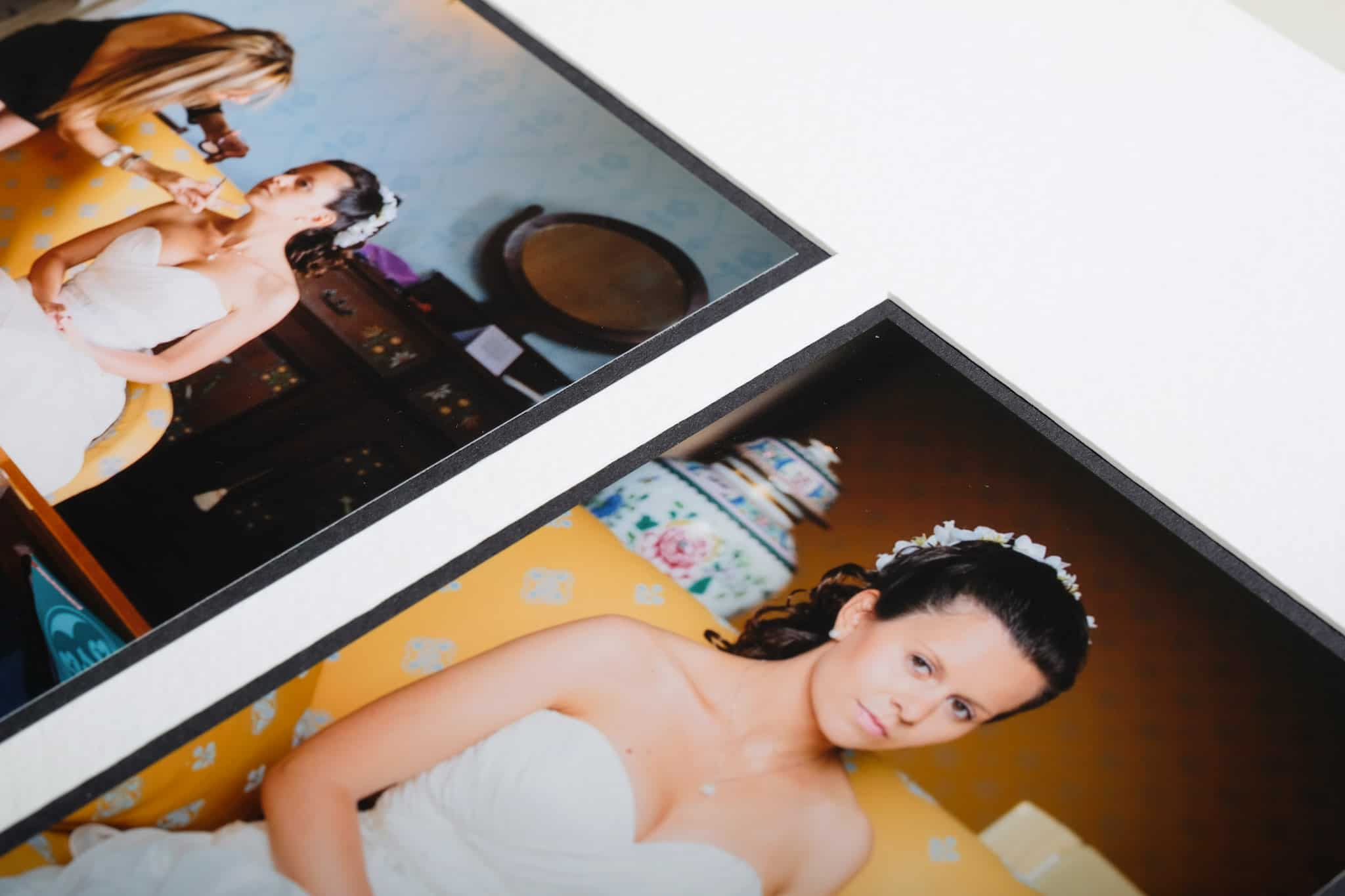 Closeup of pagemounted prints of Queensberry duo pagemount wedding photo album.