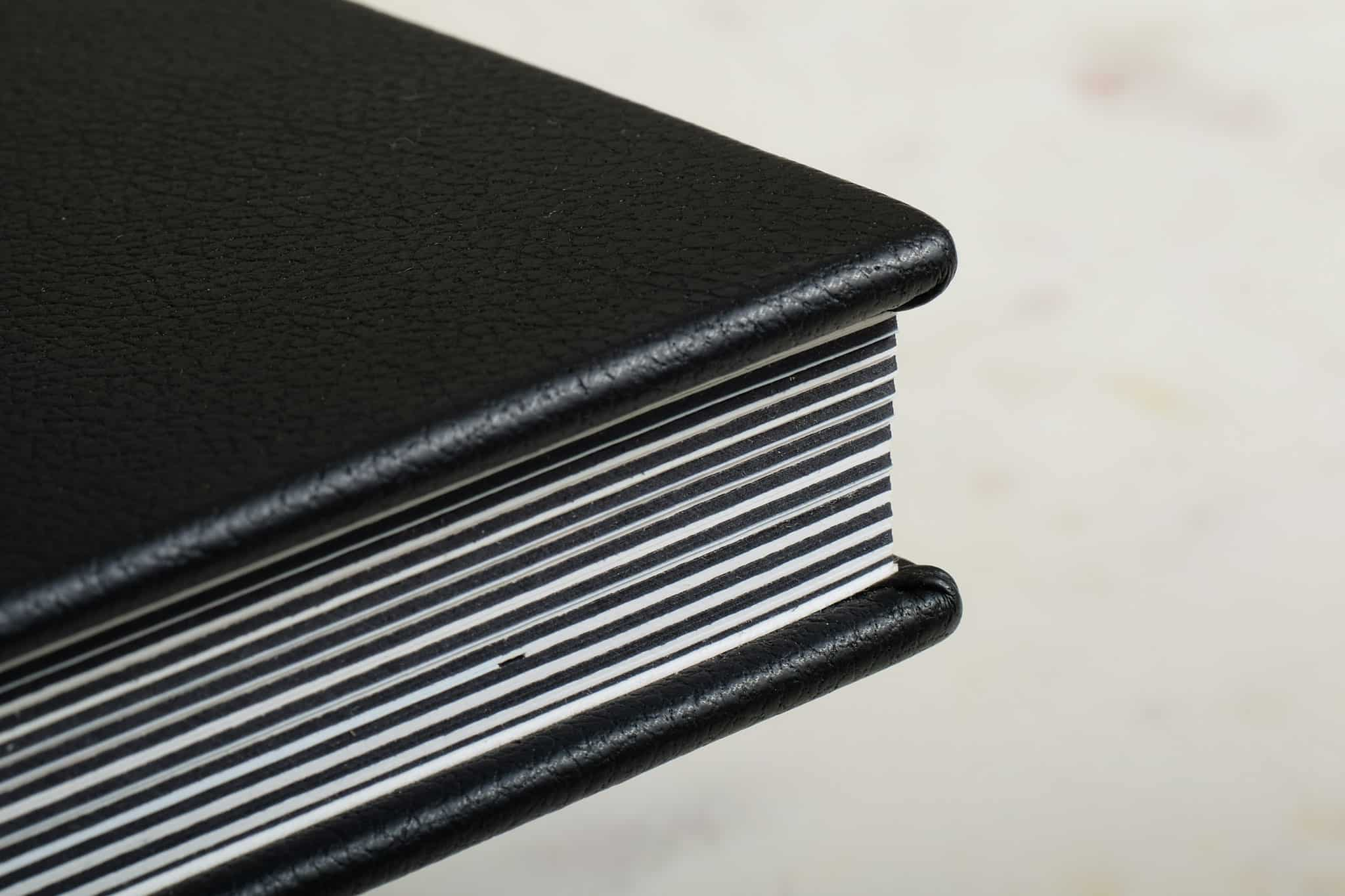 Queensberry duo wedding photo album with different coloured pages and mattes.