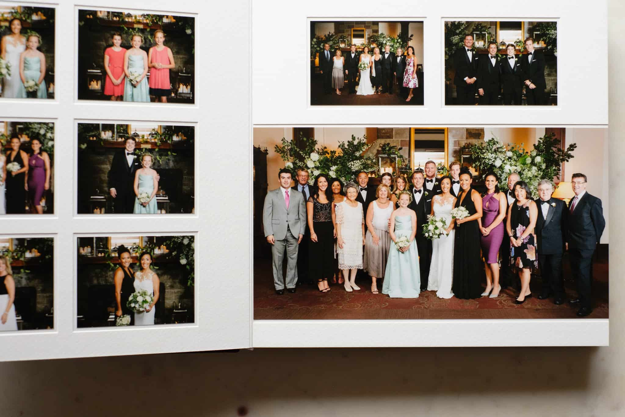 Queensberry duo wedding photo album with white pages and white mattes.