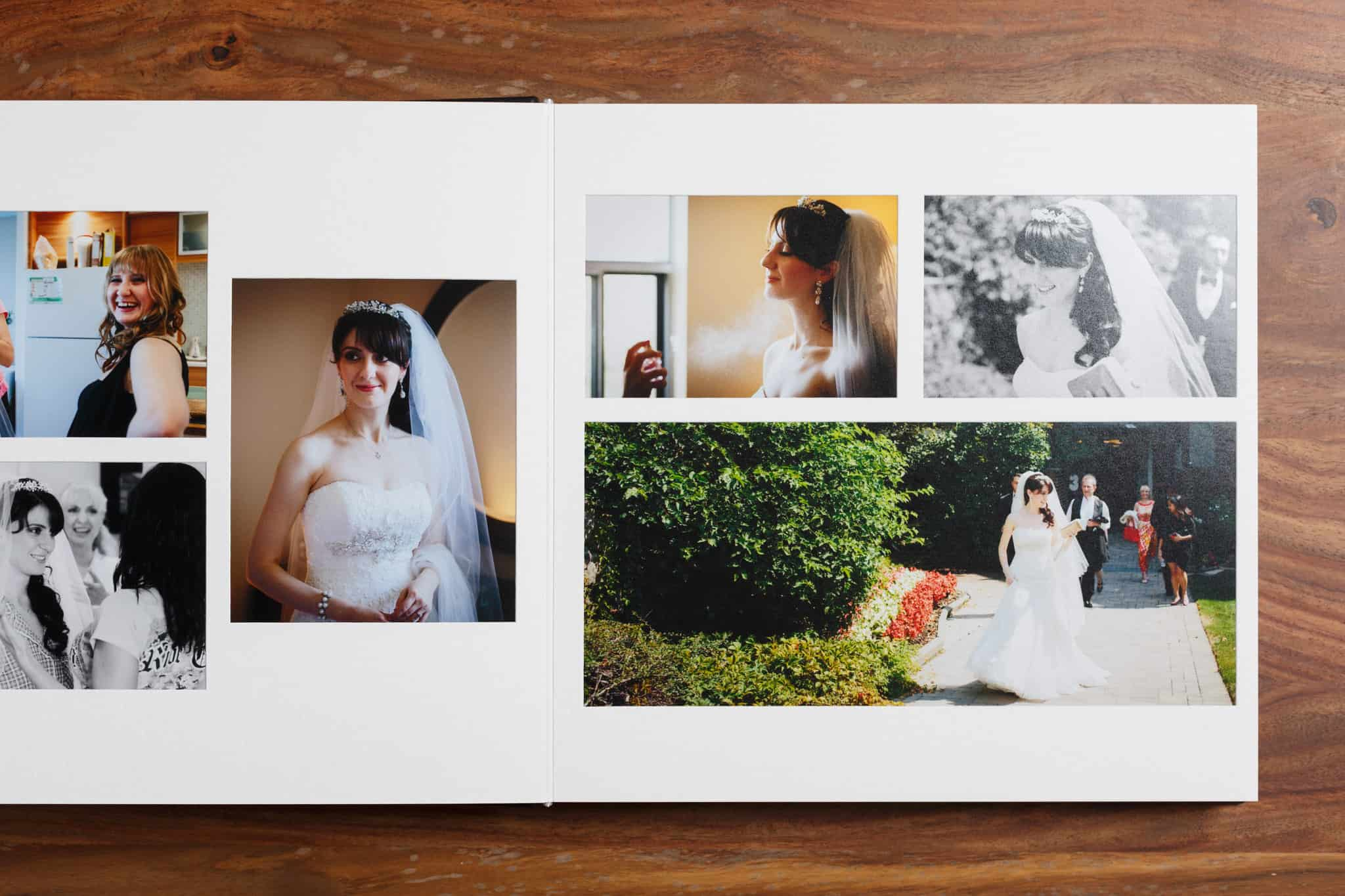 Overlay album type. Wedding photo albums on hardwood background.
