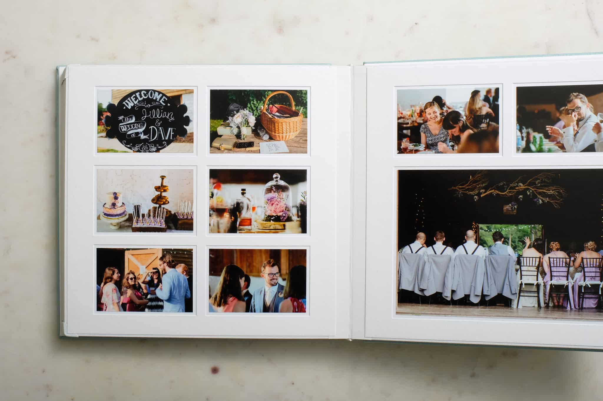 Queensberry pagemount matted wedding photo album with corner protectors.