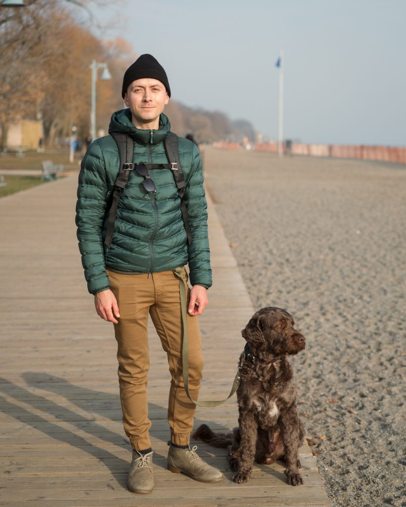 Pavel Kounine with his brown dog on beach boardwalk in Toronto.